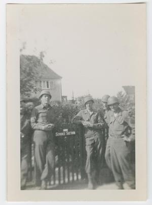 Primary view of object titled '[Five Soldiers in Front of a Fence]'.