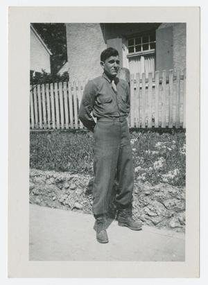 Primary view of object titled '[Man in Front of House]'.