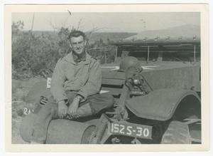 Primary view of object titled '[Frank Kurtyka on the Winch Bumper of a Half-Track]'.