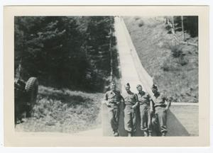 Primary view of object titled '[Four Soldiers Standing Against a Wall]'.