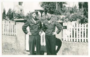 Primary view of object titled '[Vernon Foster and Earl Nichols Posing by Picket Fence]'.