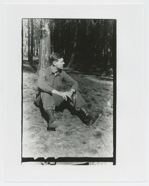 Primary view of object titled '[Officer Leaning Against Tree]'.