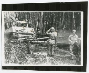 Primary view of object titled '[Tank Moving Through a Wooded Area]'.