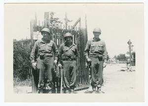 Primary view of object titled '[Three Soldiers Standing by a Gate]'.