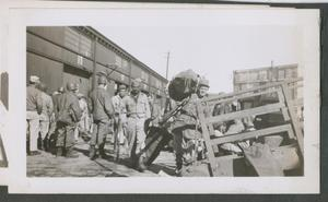 Primary view of object titled '[Gilbert Going up Gangway]'.