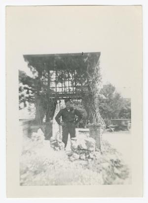 Primary view of object titled '[William Giannopoulos Standing Under an Arbor]'.