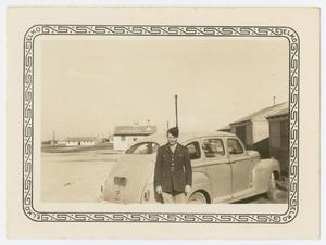 Primary view of object titled '[Lieutenant White by His Car]'.