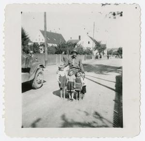 Primary view of object titled '[John Fine with Children]'.