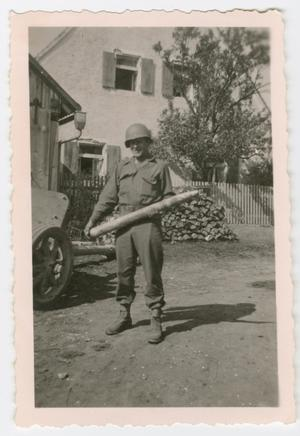 Primary view of object titled '[Soldier Holding a Large Projectile]'.
