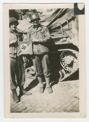 Primary view of object titled '[Two Soldiers Holding a Small Nazi Flag]'.