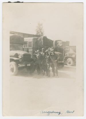 Primary view of object titled '[Five Soldiers Standing by Three Trucks]'.