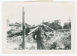 Primary view of object titled '[George Hatt Before a Collapsed Building]'.