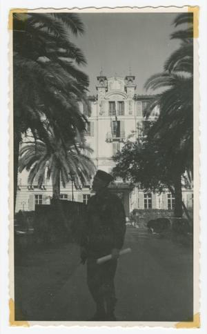 Primary view of object titled '[Soldier Standing in Front of Garden in Nice, France]'.
