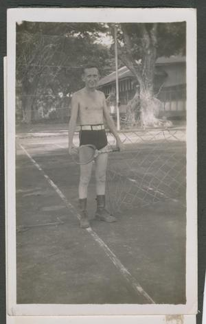 Primary view of object titled '[William Jenkins with Tennis Racket]'.