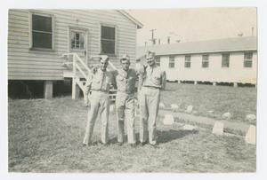 Primary view of object titled '[Three Soldiers in Barracks Area]'.
