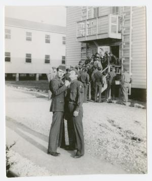 Primary view of object titled '[Group Entering Building]'.