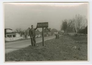 Primary view of object titled '[Soldier by Sign for Herrlischeim, France]'.
