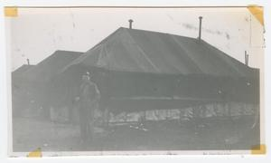 Primary view of object titled '[Soldier in Front of Large Tents]'.
