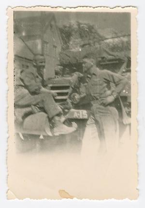 Primary view of object titled '[Paul Antonint and Carl Zutz with an Armored Car]'.