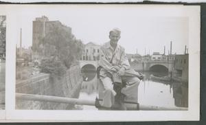 Primary view of object titled '[Soldier Sitting on Bridge]'.