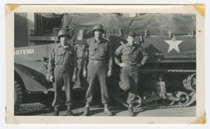 Primary view of object titled '[Three Soldiers to the Side of a Half-Track]'.