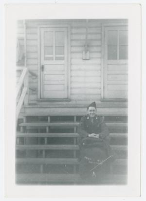 Primary view of object titled '[Man Sitting on Steps]'.