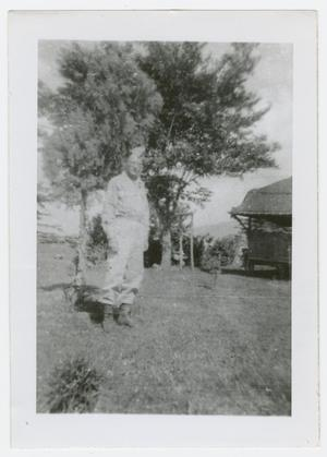 Primary view of object titled '[Verne Mauer Standing by a Tree]'.