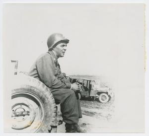 Primary view of object titled '[Colonel Charles Hartman Sitting on a Jeep]'.