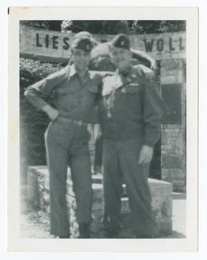 Primary view of object titled '[Two Soldiers in Front of Statue]'.