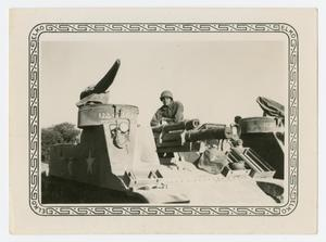 Primary view of object titled '[Lieutenant Jacobs on Gun Carriage]'.
