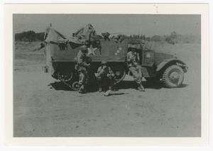 Primary view of object titled '[152nd Signal Company Men with Half-Track]'.