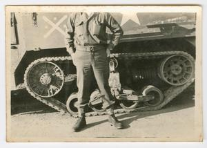 Primary view of object titled '[William Hahn Standing Before a Half-Track]'.