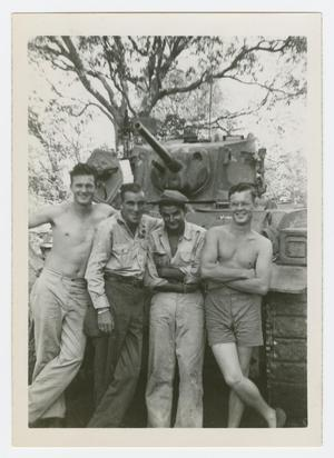 Primary view of object titled '[Four Men Standing Against a Tank]'.