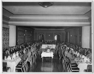 Primary view of object titled 'Large Banquet Hall Filled with Men'.