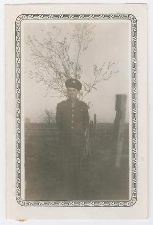 Primary view of object titled '[Edward Scott Standing by a Fence]'.