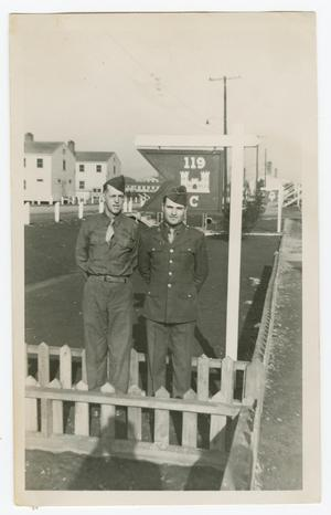 Primary view of object titled '[Ed Scott and Paul Wright Standing by Battalion Sign]'.
