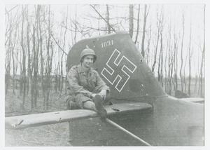 Primary view of object titled '[Soldier Sitting on Aircraft]'.