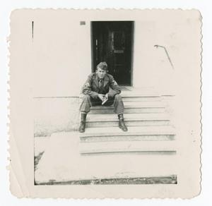 Primary view of object titled '[Soldier on Steps of Building]'.