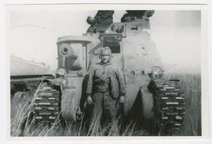 Primary view of object titled '[James Lucci in Front of an M3 Tank]'.