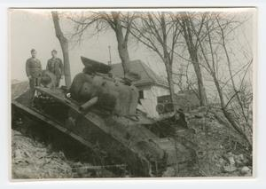Primary view of object titled '[Two Soldiers Posing by Wrecked Sherman Tank]'.