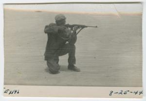 Primary view of object titled '[William Giannopoulos Firing a Carbine]'.