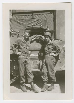 Primary view of object titled '[Homer Petross and His Driver Standing with a Truck]'.