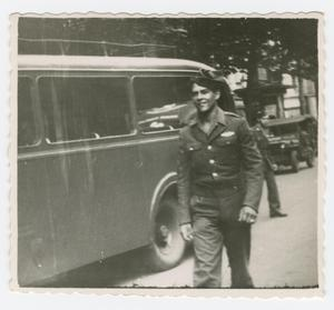 Primary view of object titled '[William Hahn Standing by an Army Bus]'.
