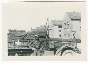 Primary view of object titled '[Arlo Ward by a Half-Track]'.