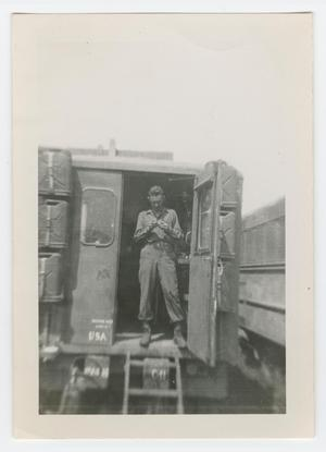 Primary view of object titled '[Soldier Standing in Doorway of a Maintenance Van]'.