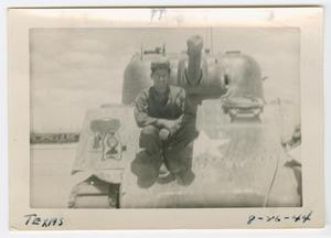 Primary view of object titled '[William Giannopoulos Sitting on an M4 Tank]'.