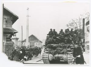 Primary view of object titled '[Soldiers Riding a Tank in a Town]'.