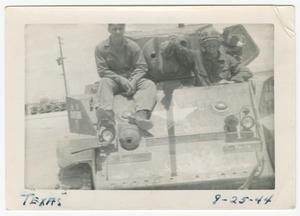 Primary view of object titled '[Richard Mauger and William Giannopoulos on an M5 Tank]'.