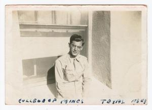 Primary view of object titled '[William Giannopoulos Posing Before His College Bedroom]'.