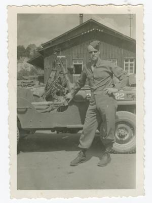 Primary view of object titled '[Oliver Johnson Leaning on a Jeep]'.